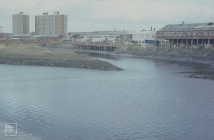 By-Passed loop of the River Taff. Butetown from Clarence road bridge. 1970s before the original channel cut off.