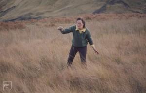 Jenny Tann mud grovelling for plants. Maerdy November 1971