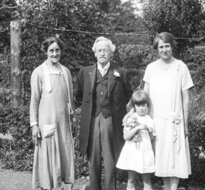 Mary stands close to her mother, with her grandmother and great grandfather, 1925.
